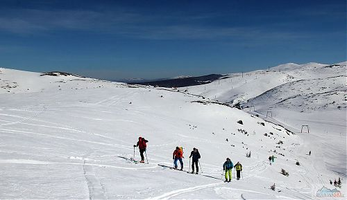 A group of skitourers on the way to the summit